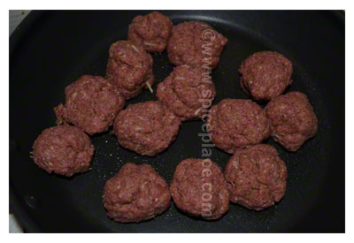 Uncooked Spatini Beef Meatballs in pan